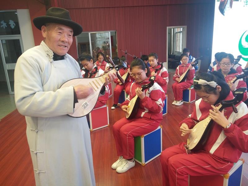 王广超:传承湖区文化  土琵琶进课堂